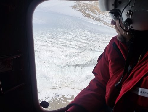 Bell 212 helicopter as it flies over Antarctica