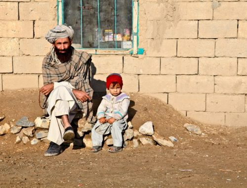 Man and child sitting in Afghanistan